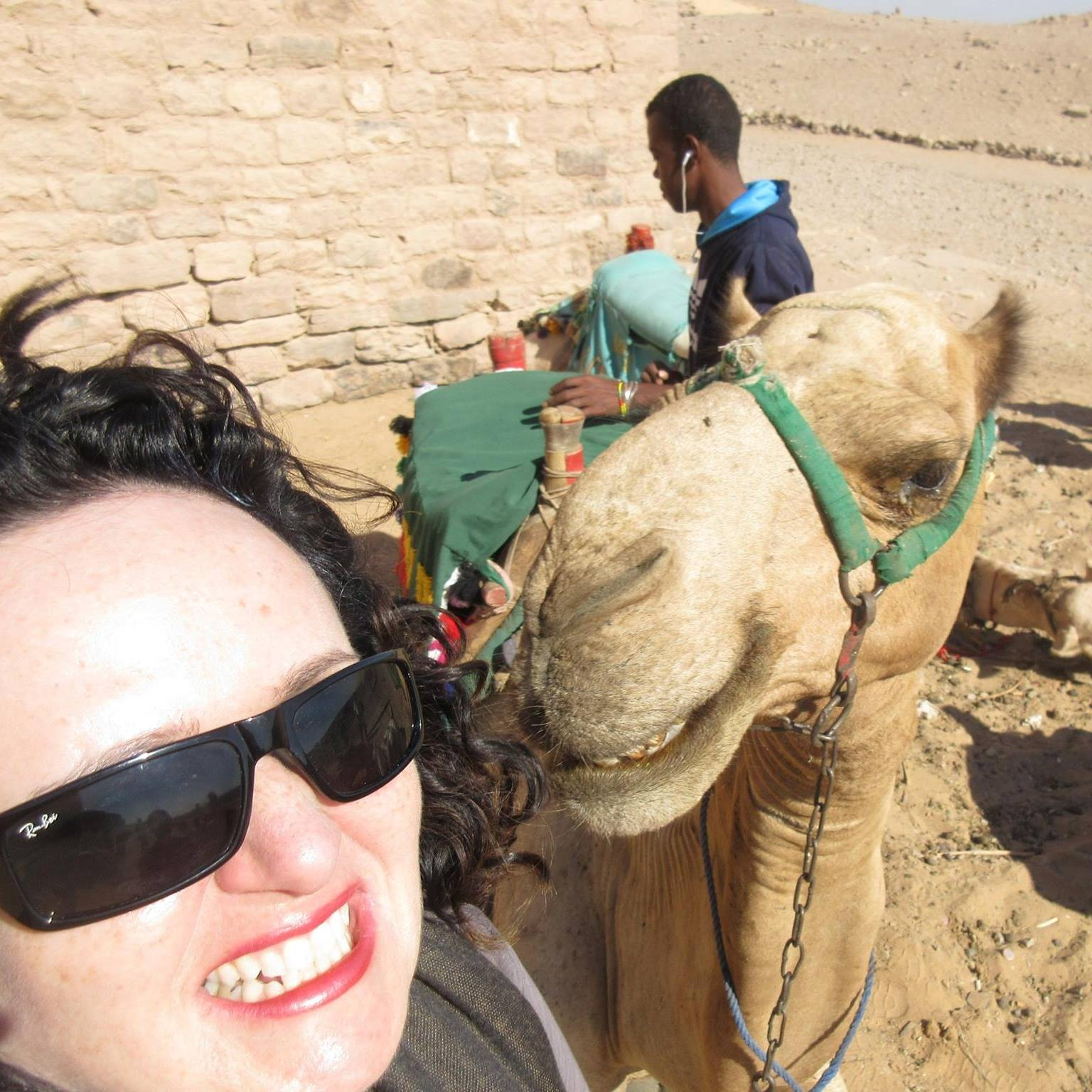 Laura in Egypt with a Camel and locals